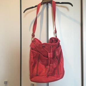 Red drawstring tote bag